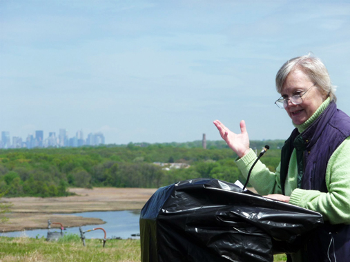 Beth Gorrie, Director of Staten Island OutLOUD, addressed the crowd atop North Mound last Saturday.