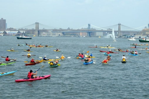 Kayakers in the harbor near Governor's Island during last year's City of Water Day.